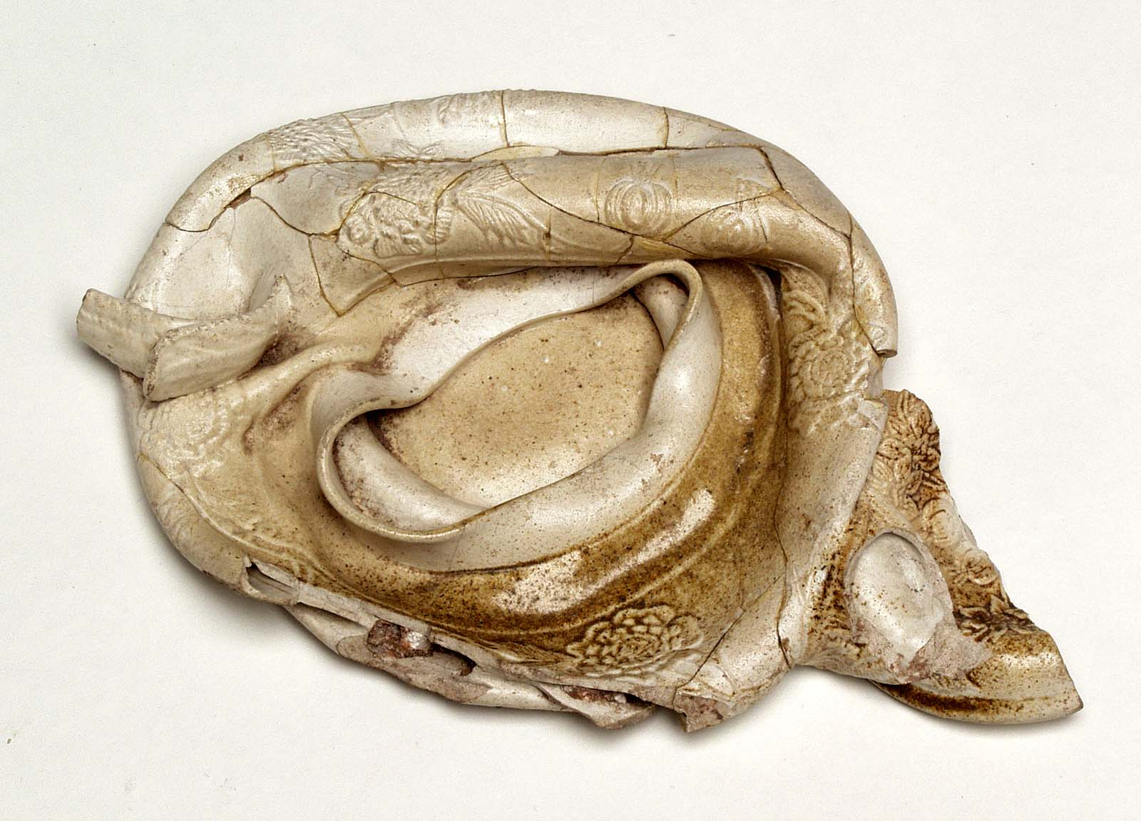 photo of a twisted and miscast piece of ceramic ware