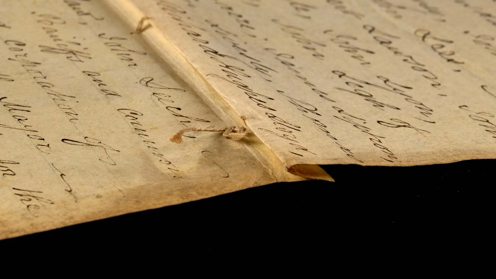 close up of handwritten words on parchment