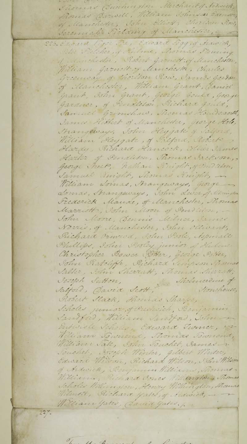 photo of a long piece of parchment with handwriting in ink