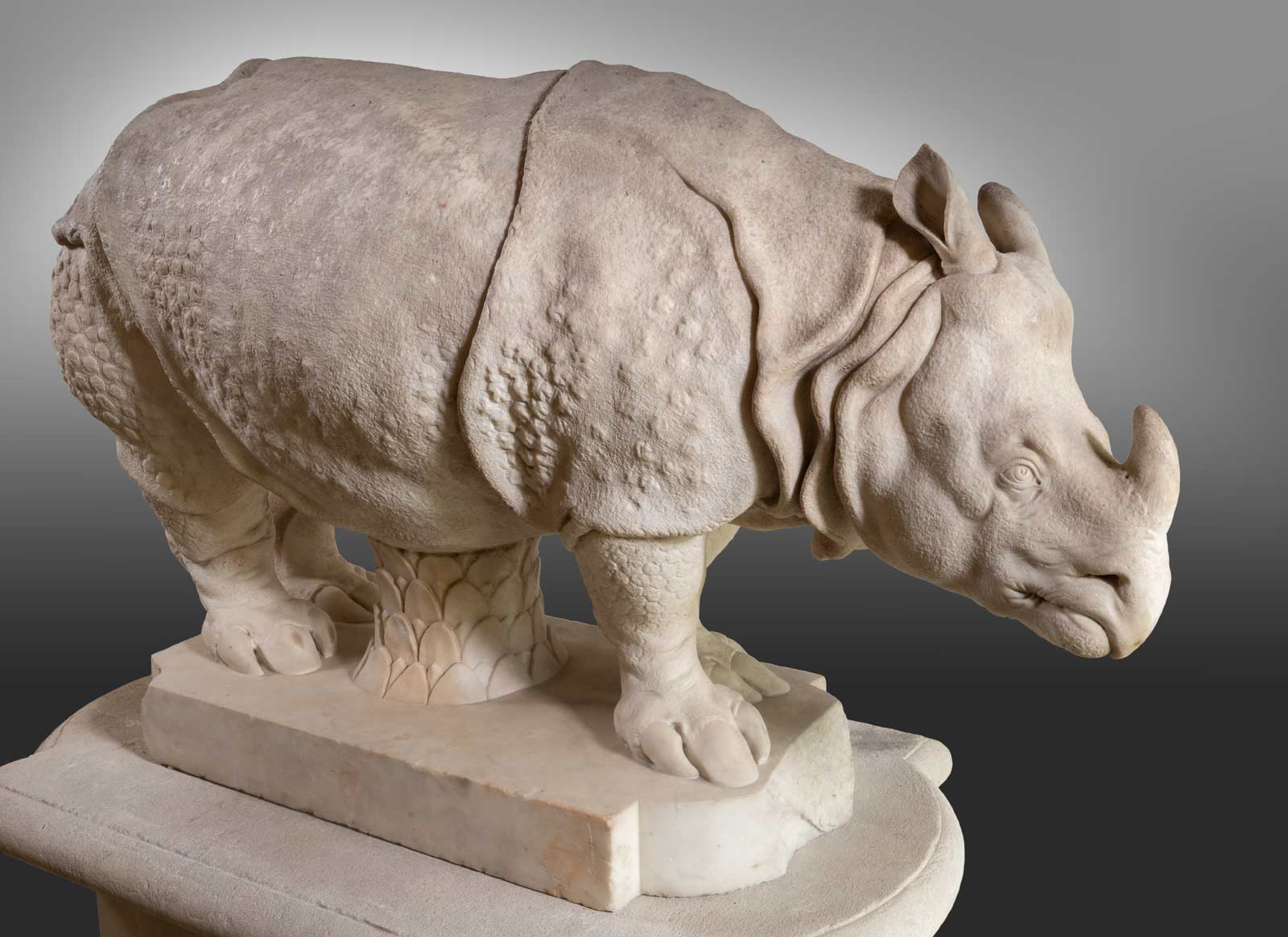 a marble carving of a rhinoceros