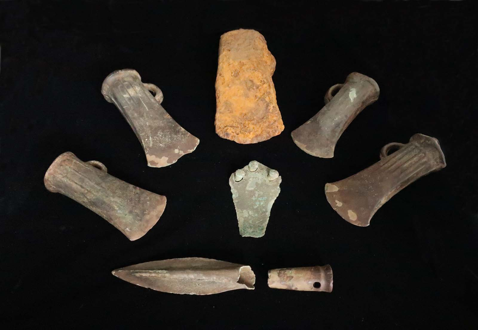 photo of various socketed axe heads and a spear head