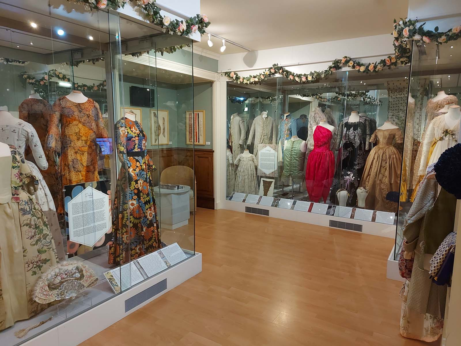 gallery shot of cases with dresses and other costume displayed within them