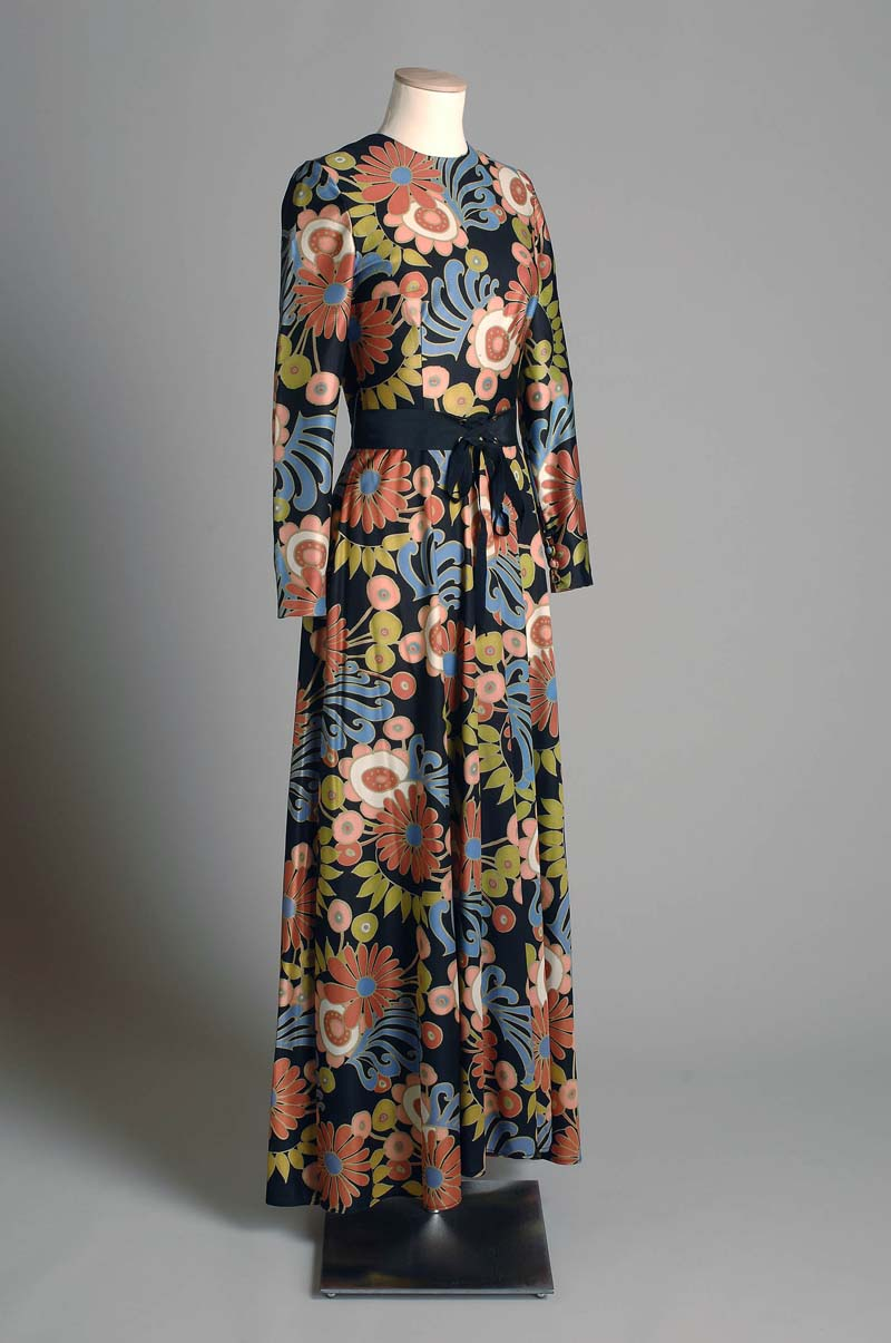 photo of a long floral patterned dress on a mannequin