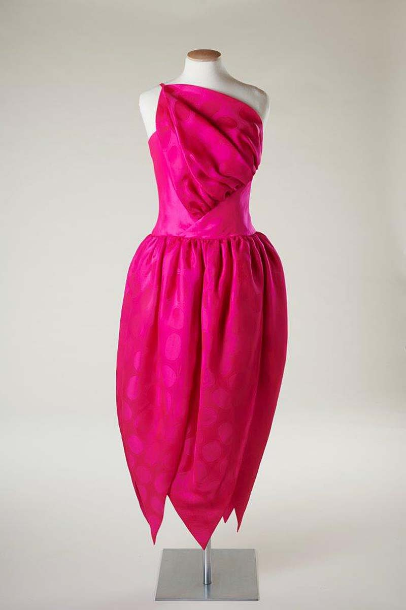 photo of a shocking pink dress with cosseted waist and petal form hem