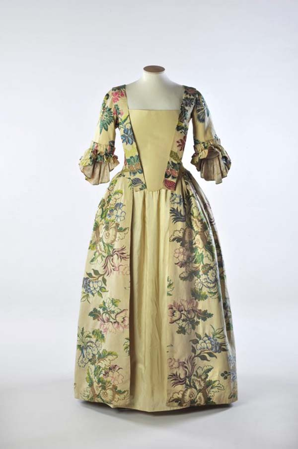 photo of a Georgian style dress with lemon coloured front panel and floral pattern over lemon fabric