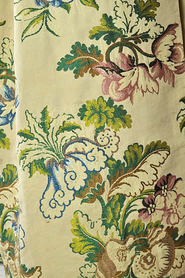 close up detail of floral patterns against a lemon fabric background
